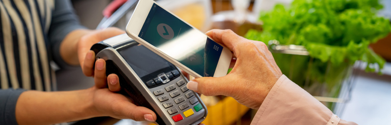 person paying with smartphone
